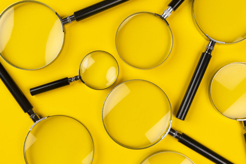 magnifying glasses on the yellow background