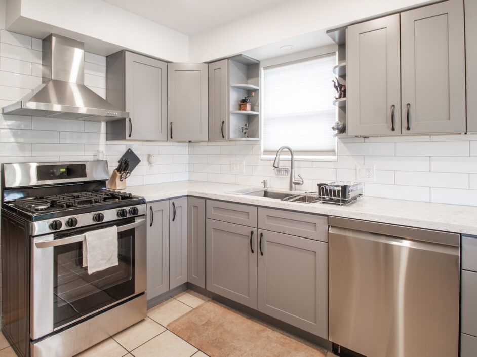 kitchen with grey cabinets and stainless steel appliances
