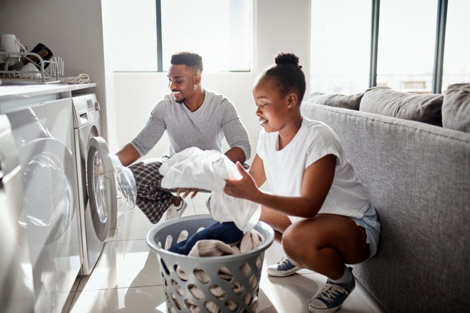 couple doing laundry together at home
