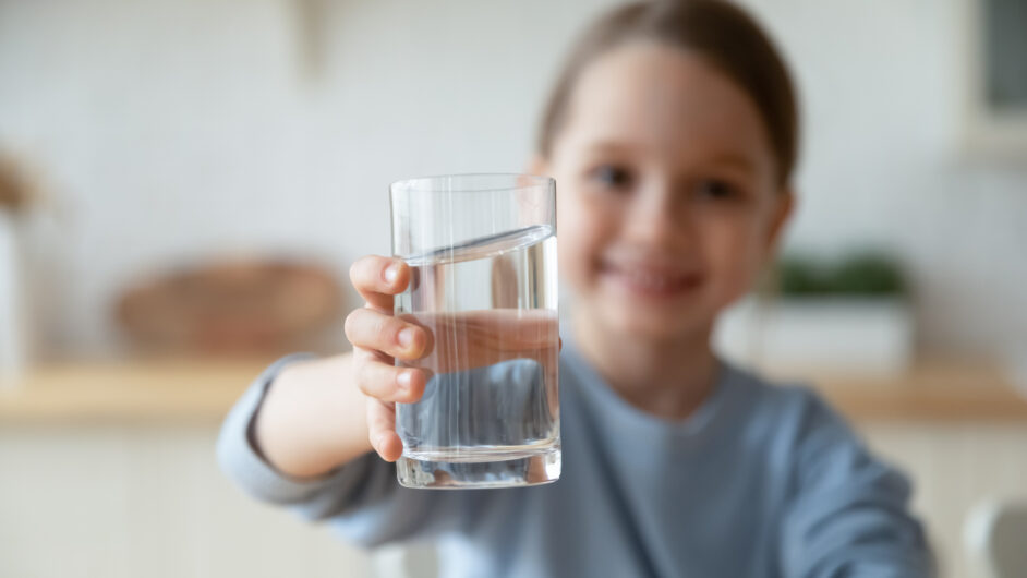 girl holding water glass