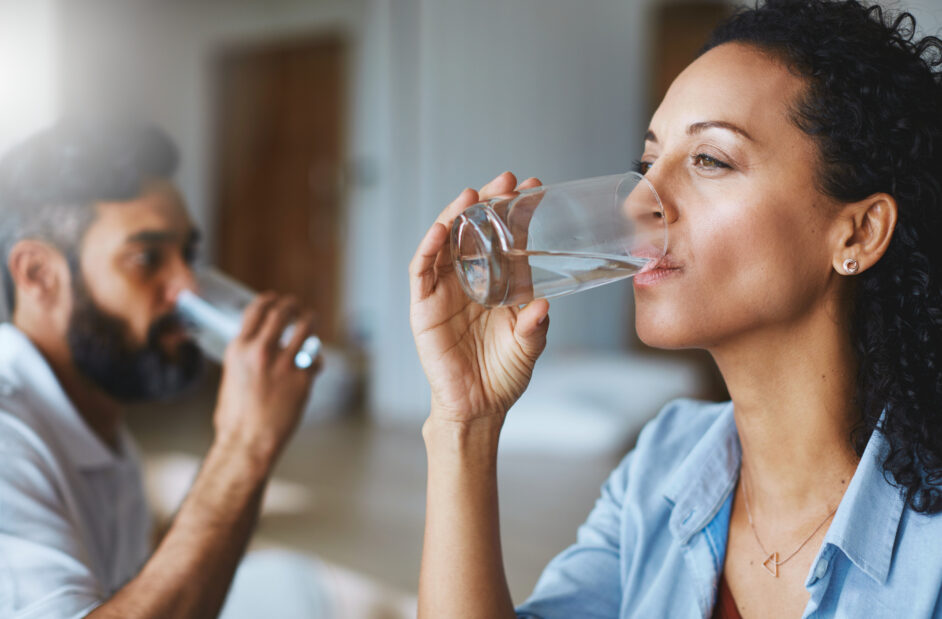 couple drinking glasses of water together